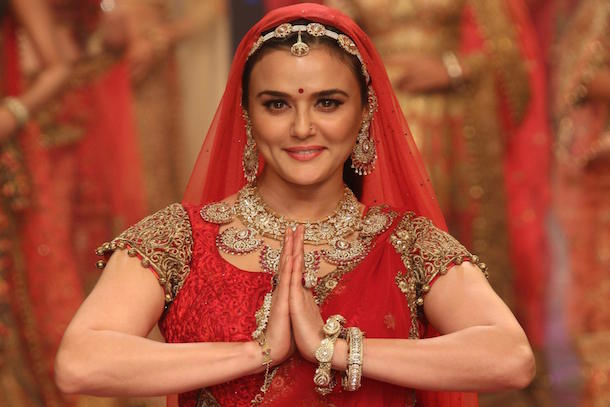 Preity Zinta as Mughal Empress, Jodha Bai, dressed in a royal red lehenga choli and delicate kundan and polki jewellery. The traditional borla drop matha patti and necklace were particular standouts.